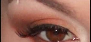 Apply a cream , orange and brown eye makeup look