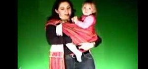 Carry a toddler in a sling with the hip carry position