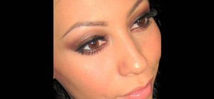 Create a black and brown smokey eye makeup look