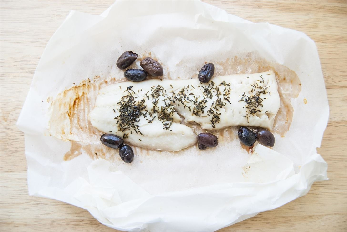 cooking fish in parchment paper Parchment fish packets make a quick and elegant meal how to: use parchment paper to cook fish.