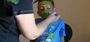 Face paint the Teenage Mutant Ninja Turtle Michelangelo