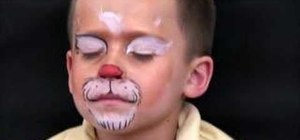 "Apply ""Rudolph The Reindeer"" face paint"