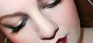Create a Fall 2010 runway inspired golden eye and plum lip look