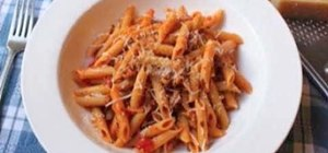 Prepare penne pasta with spicy sausage ragu