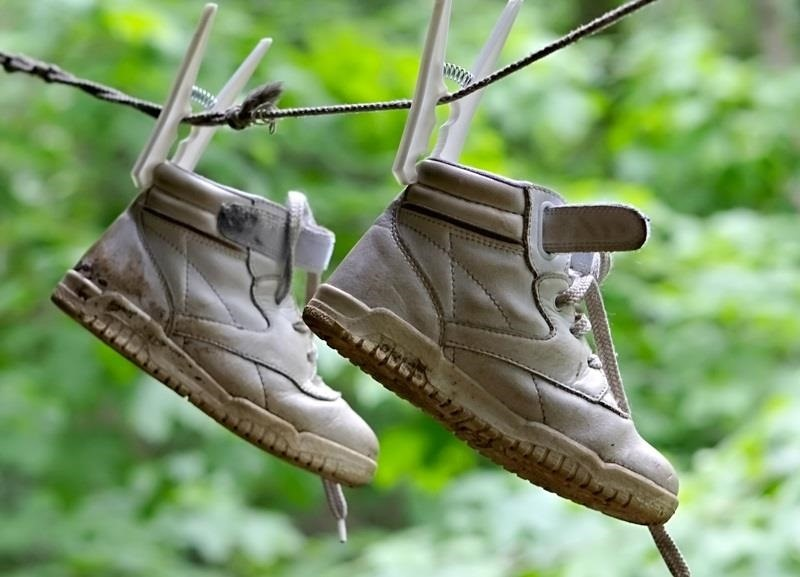 How to Dry Your Soaking Wet Shoes Faster—Without Shrinking Them in the Dryer