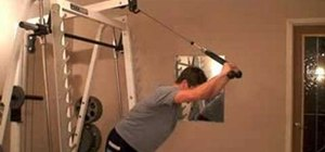 Strength train with overhead cable triceps extension