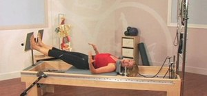 Correct spinal asymmetries with a Pilates T-bar