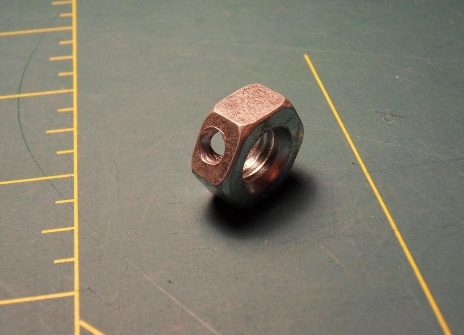 How to Build a Tiny LED Flashlight Out of Nuts, Bolts, and Washers