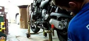 Remove the rear wheel on a Honda 919 motorcycle