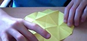 Fold a cute origami fish that kisses