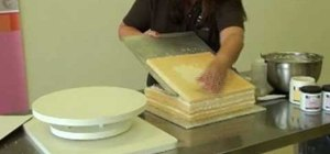 Level (tort) a cake and add icing filling