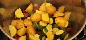Make a sausage, potato, and zucchini stew