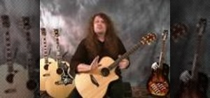 Play the D7 chord on the acoustic guitar