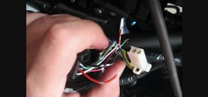 Fix the wiring harness on a Ninja 250R motorcycle