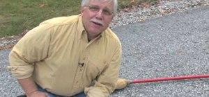 Repair blacktop driveway cracks