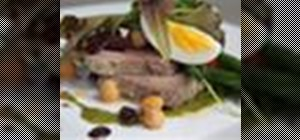 Make a classic tuna Niçoise salad with tomatoes, olives and herbs