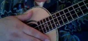 Strum a rumba rhythm on the ukulele
