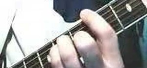 Play bar chords on the acoustic guitar