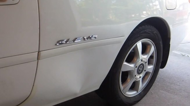 How To Fix A Huge Dent In Your Car At Home Without Ruining