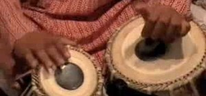 Play an uthan, or opening flourish, on the tabla