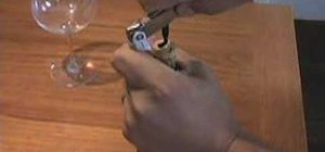 Open a wine bottle with a waiter's corkscrew