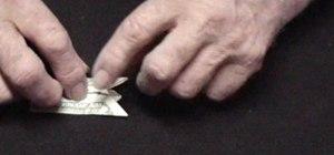 Origami a dollar bill finger puppet
