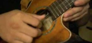Play the ukulele with the three finger roll