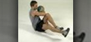 Tone abs with a medicine ball bicycle maneuver