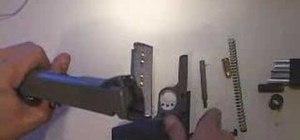 Field strip a Springfield 1911-A1 .45 cal pistol