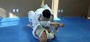 Do a Jiu Jitsu switch back sweep