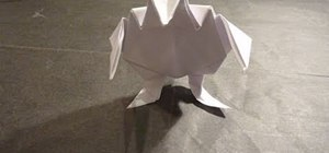 Fold an intermediate level origami fighting toad