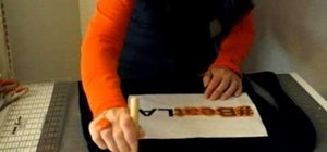 Use freezer paper to stencil a hash tag design onto a t-shirt