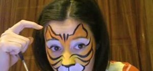 Paint a face in a tiger design