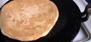 Make Indian mooli ka paratha flat bread with radishes