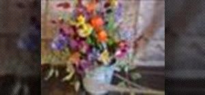 Make a fall watering can flower arrangement