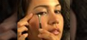 Apply liquid eyeliner to accentuate eyes