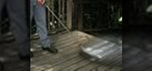 Pressure wash a wood deck