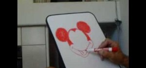 Draw Mickey Mouse on a dry-erase board