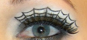 Create a spiderweb eye makeup look for Halloween