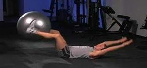 Do a hand to foot stability ball pass
