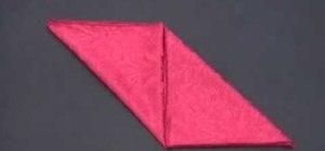 Fold an origami bishop's cap napkin design