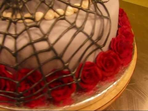 Decorate a two tier cake with sugarveil icing and spiderwebs