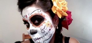 Create a Dia de los Muertos candy skull makeup look for Halloween