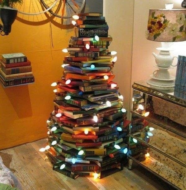this diy alternative christmas tree is a great way to use what you already have stack the books in circles and wrap a string of lights around it and