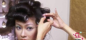 Volumize pin-straight hair with hot rollers