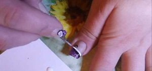 Creat white, purple & black swirl nail art
