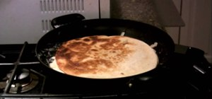 Make a ham and cheese quesadilla