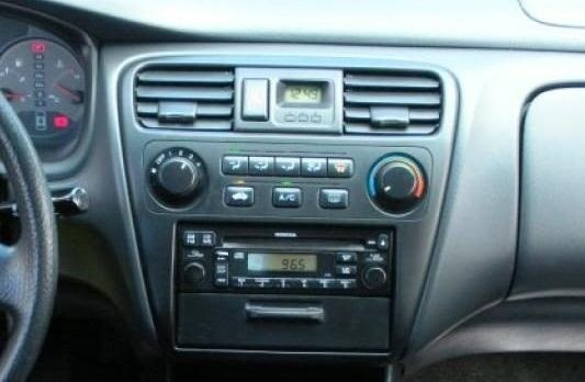 Upgrade Your Car's Digital Clock with a Dash-Mounted iPod Nano