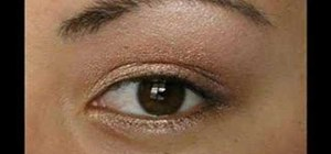 Create a shimmering gold eye shadow look