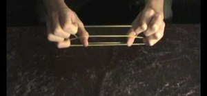Perform the rubber band magic trick